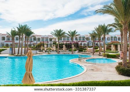 Swimming pool of luxury garden territory. - stock photo