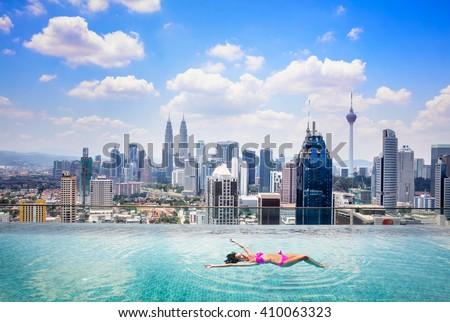 Swimming pool on roof top with beautiful city view kuala lumpur malaysia - stock photo