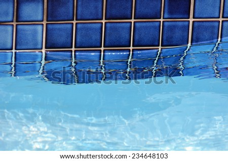 Swimming pool poolside and water background texture. - stock photo