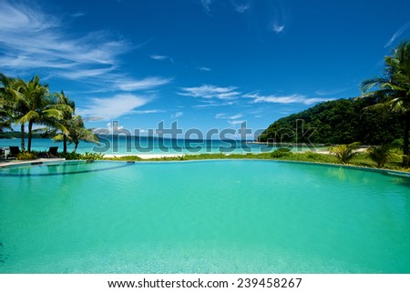 Swimming pool resort vacation on Boracay Island in the Philippines. - stock photo