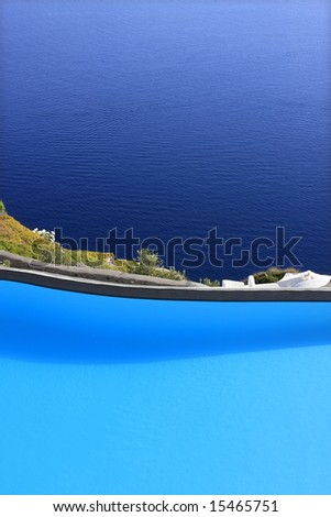 Swimming pool set on a hill overlooking the sea. - stock photo