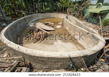 Swimming pool under construction - stock photo