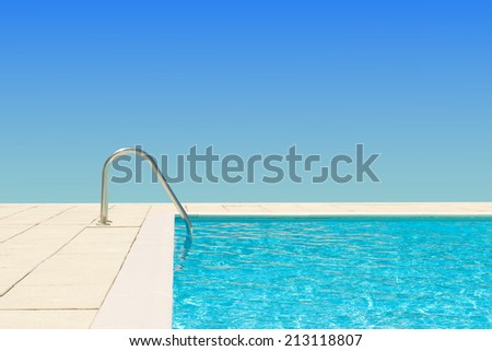 swimming pool water on blue sky background - stock photo