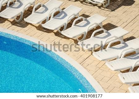 swimming pool with blue water - stock photo