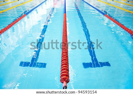 Swimming pool with clear blue water, and markup. No one. - stock photo