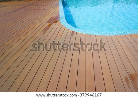 swimming pool with fake wood flooring stripes summer vacation - stock photo