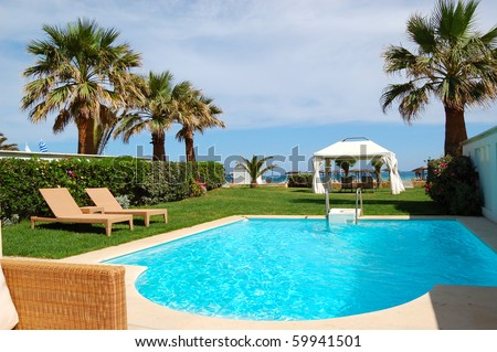 Swimming pool with jacuzzi at the beach of modern luxury villa, Crete, Greece - stock photo