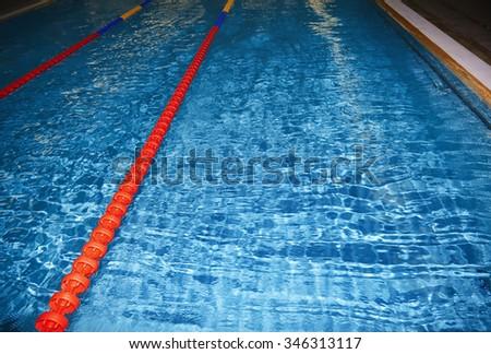 Swimming pool with lane markers. Horizontal photo - stock photo