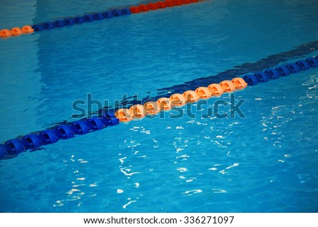 Swimming pool with lane markers. Vertical photo - stock photo