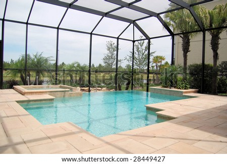 Swimming pool with negative edge and cage - stock photo