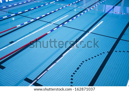 Swimming pool with race tracks or lanes - stock photo