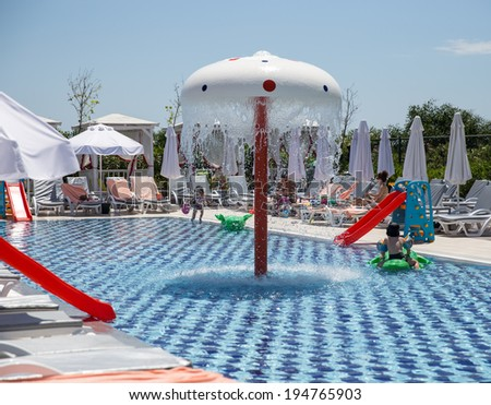 Swimming pool with slides for little kids - stock photo