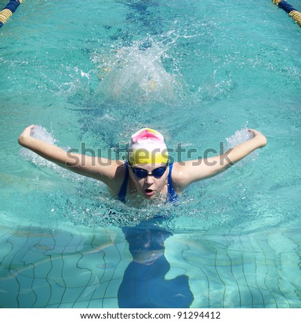 Swimming woman performing butterfly style - stock photo