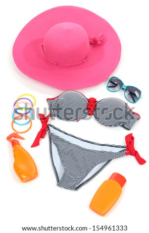 Swimsuit and beach items isolated on white - stock photo