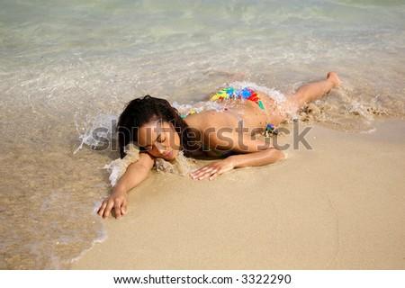 swimsuit girl laying on beach - stock photo
