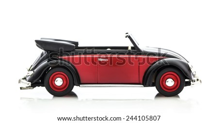 SWINDON, UK - DECEMBER 14, 2014: Convertible VW Beetle in Red and Black, Die cast model on a white background. - stock photo