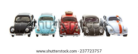SWINDON, UK - DECEMBER 14, 2014: Five Old Retro VW Beetle Die cast models on a white background. - stock photo