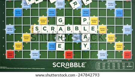 SWINDON, UK - JANUARY 28, 2015: Scrabble Word Game showing the playing board, Scrabble is made by Mattle - stock photo