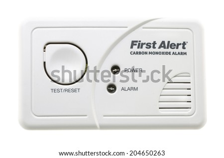 SWINDON, UK - JULY 13, 2014:  First Alert CO Carbon Monixide Alarm on a White Background - stock photo