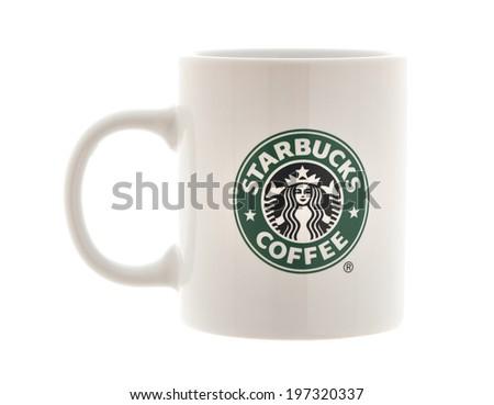 SWINDON, UK - JUNE 8, 2014: White Starbucks  Mug with Starbucks logo on a White Background, Starbucks is the largest coffeehouse company in the world - stock photo