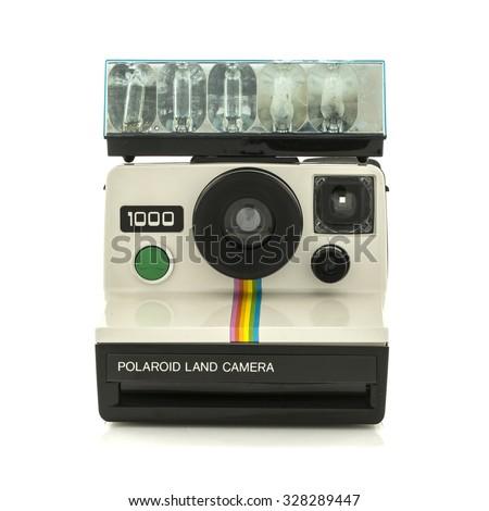SWINDON, UK - OCTOBER 17, 2015: Retro Polaroid 1000 Land Camera With Flash Bulbs on a White Background - stock photo