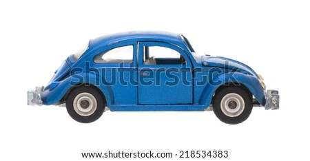SWINDON, UK - SEPTEMBER 21, 2014: Old Dinky Die Cast VW Model Car Scale: 1:42  Blue Volkswagen Beetle 1300 Sedan De-Luxe on a White Background, Produced: From 1965 to 1975 - stock photo
