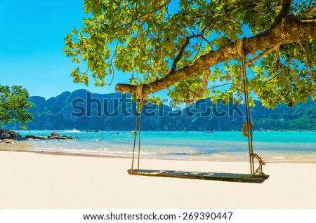 Swing hang from coconut tree over beach, Phi Phi Island, Thailand - stock photo