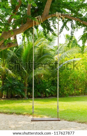 swing in the garden - stock photo