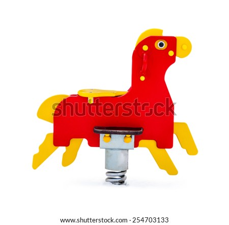 Swing in the shape of the horse for playground - stock photo
