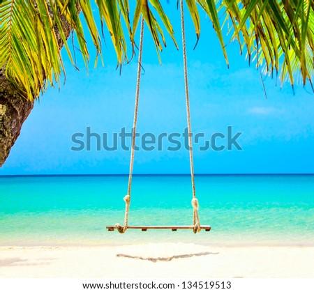 Swing on the beach - stock photo