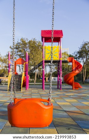Swing seat on children playground without children - stock photo