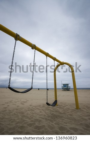 Swing Set and Life Guard Tower at the Beach - stock photo