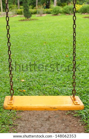 Swings in the playground . - stock photo