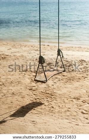 Swings on the tropical beach. - stock photo