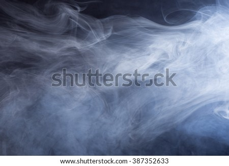 Swirling glowing smoke for an abstract background - stock photo