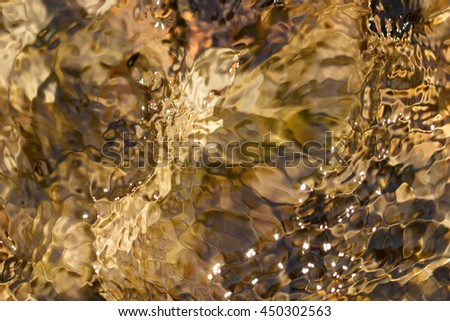 Swirling ripples of water - stock photo