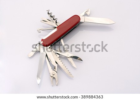 Swiss army knife against white background - stock photo