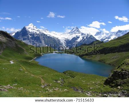 Swiss beauty, Schreckhorn and Wetterhorn above Bachalpsee - stock photo