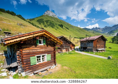 Swiss Chalet In The Mountains of The Alps In Switzerland - stock photo