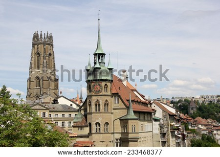 Swiss City Fribourg: Cathedral of Saint Nicholas and Town Hall - stock photo
