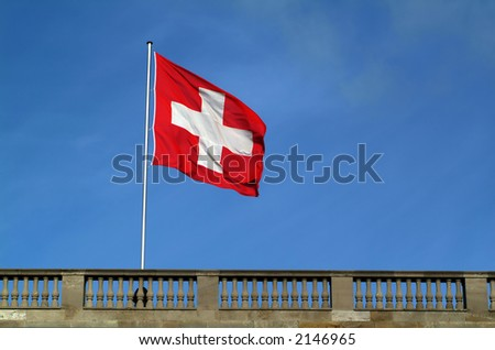swiss flag on top of swiss embassy in berlin - stock photo