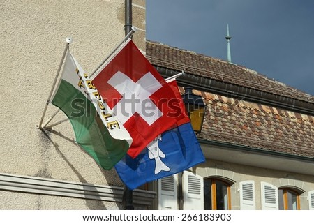Swiss Flags on a Building in Nyon, Switzerland - stock photo