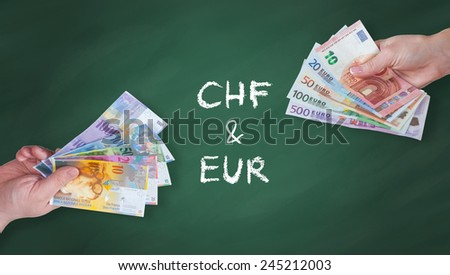 Swiss Franc and Euro banknotes on green board - stock photo