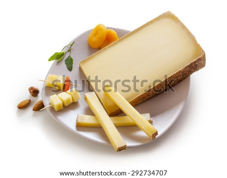 Swiss Gruyere cheese in a plate on white background - stock photo