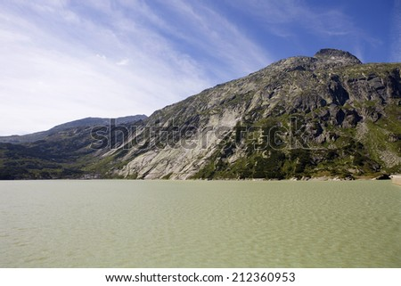 swiss lake at the top of the mountains, switzerland - stock photo