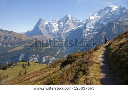 Swiss landscape and hiking path in the Alps - stock photo