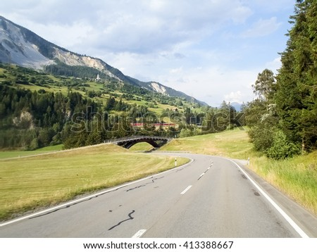 Swiss landscape, mountains and green meadows, mountains and green meadows - stock photo