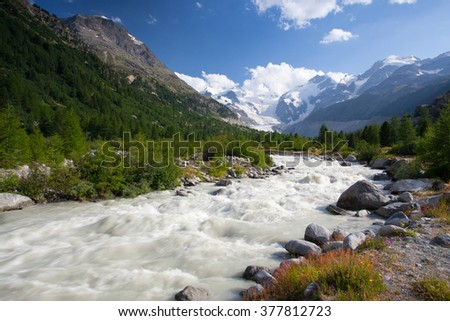 Swiss mountain landscape of the Morteratsch Glacier Valley hiking trail in the Bernina Mountain Range - stock photo