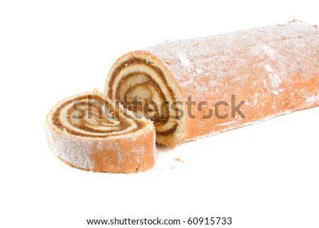 Swiss roll closeup isolated on a white background - stock photo