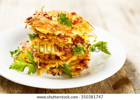 Swiss rosti with ham on plate - stock photo